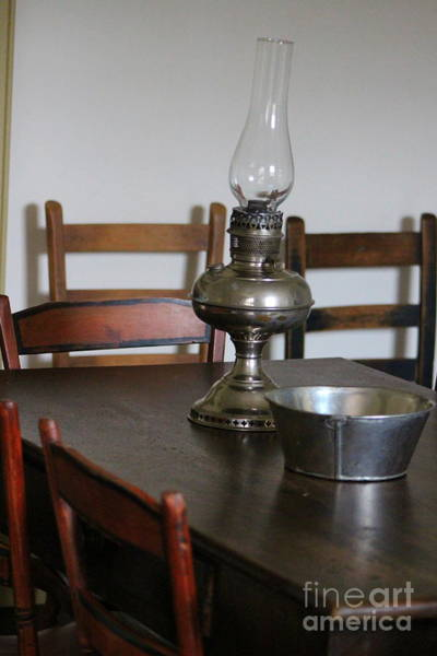 Photograph - Antique Hurricane Lamp On Table by Colleen Cornelius