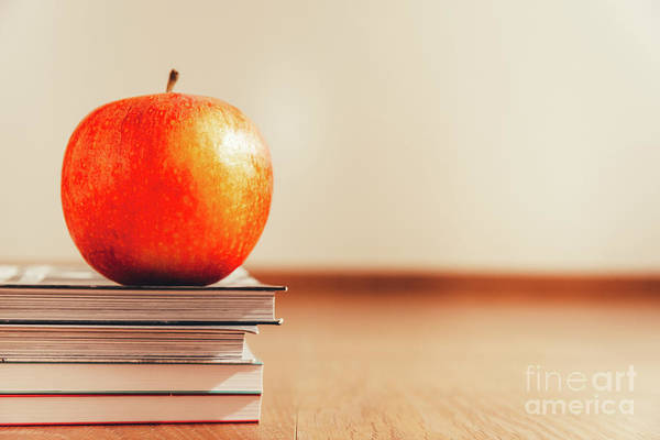 Photograph - Apple Over Books Isolated On White Background And Wooden Floor, Concept Of Healthy Life. by Joaquin Corbalan