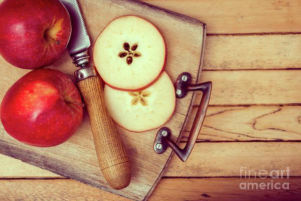 Wall Art - Photograph - Apples On Chopping Board by Amanda Elwell