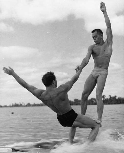 Pulling Photograph - Aqua Acrobatics by Keystone Features