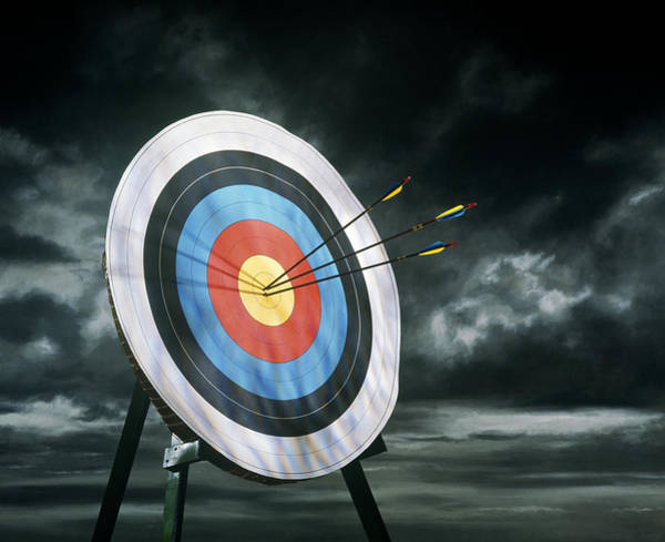 Archery Photograph - Archery Target With Arrows, Dark Clouds by Getty Images
