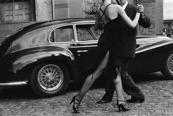 Street Photograph - Argentina, Couple Dancing Tango By Car by Christopher Pillitz