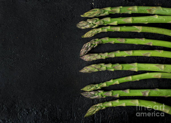 Photograph - Asparagus On Rustic Black Background by Jelena Jovanovic
