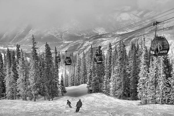 Photograph - Aspen Skiers Under The Gondola Black And White by Adam Jewell