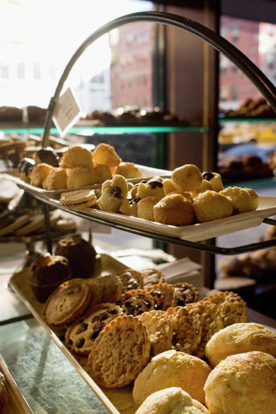 Items Photograph - Assorted Pastries On Display In A Cafe by David Mcglynn