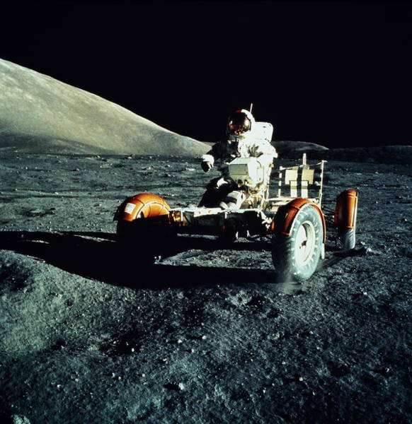 Vertical Perspective Photograph - Astronaut Driving Lunar Roving Vehicle by World Perspectives