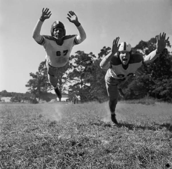 Football Helmet Photograph - At Full Stretch by Orlando