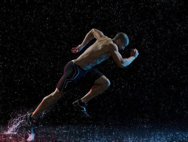 Endurance Race Photograph - Athlete Runner Running Through Rain by Jonathan Knowles