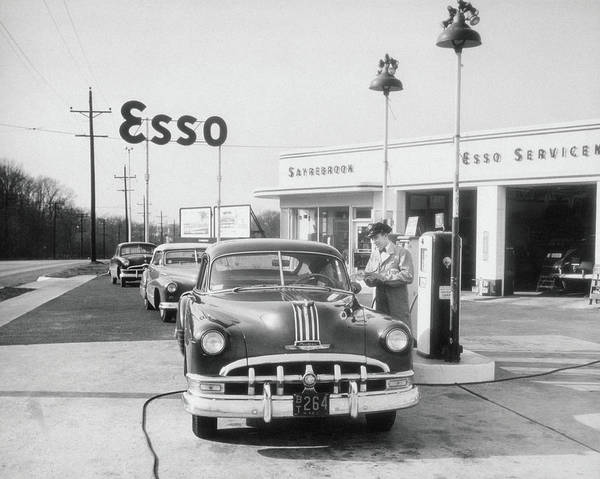 Customer Photograph - Attendant At Esso Serving Customer by Archive Holdings Inc.