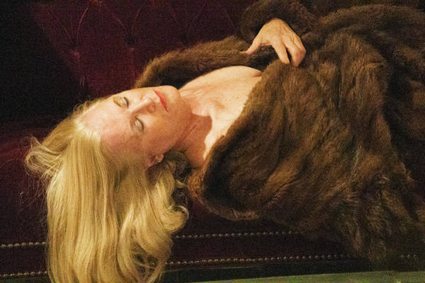 Photograph - Attractive Blonde Lady In A Fur Coat On Couch by Dan Friend