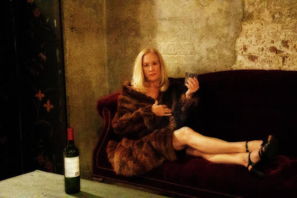 Photograph - Attractive Older Woman With Drink In Her Hand On Couch In A Fur by Dan Friend