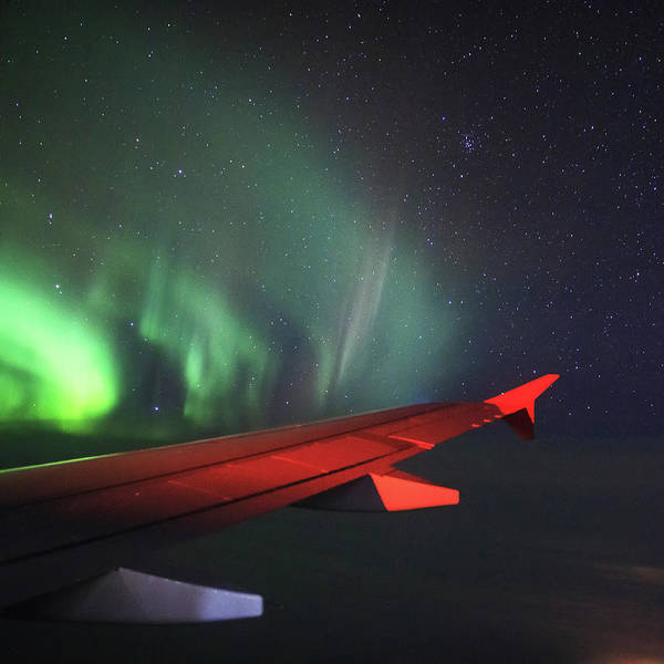 Photograph - Aurora Borealis Outside Of An Airplanes by Jeff Dai
