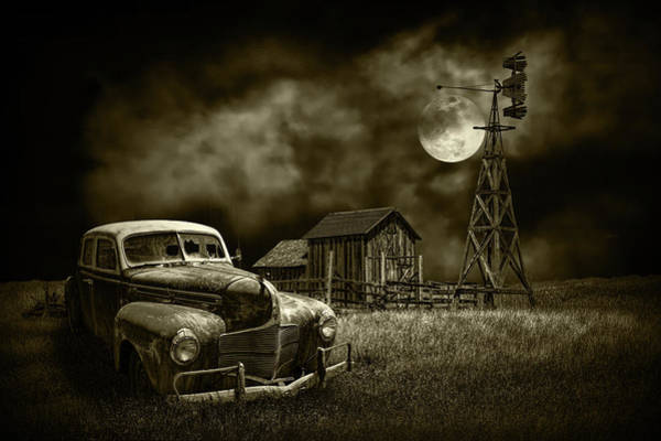 Photograph - Automobile And Barn With Windmill By Moon Light In Sepia Tone by Randall Nyhof