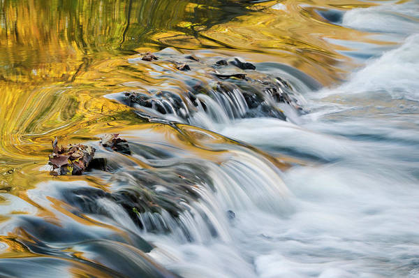 Horizontal Abstract Photograph - Autumn Reflections In Stream by Ogphoto