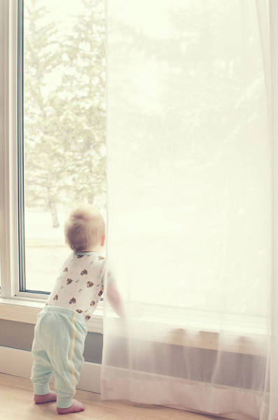 Wall Art - Photograph - Baby At Window Watching Snow Fall by Www.reneebonuccelli.com