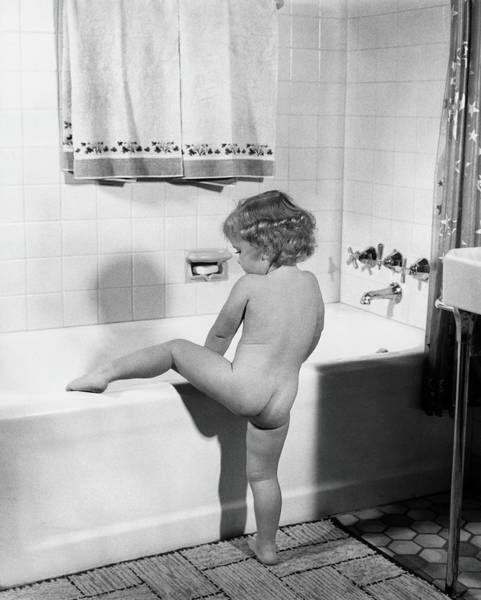 Standing Photograph - Baby Girl Climbing Into Bath Tub by H. Armstrong Roberts