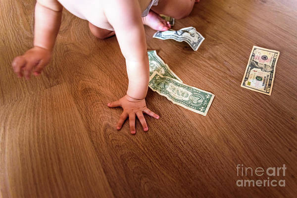 Photograph - Baby Playing With Some Dollar Bills He Has Found On The Floor Of by Joaquin Corbalan