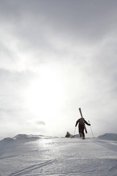 Wall Art - Photograph - Backcountry Skier Climbs Slope by Steve Casimiro