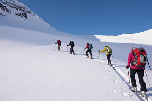 Ski Tracks Wall Art - Photograph - Backcountry Skiers Climbing Snowy Slope by Darryl Leniuk
