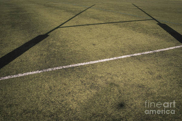 Photograph - Background Of A Rugby Goal Casting Shadows On The Field. by Joaquin Corbalan