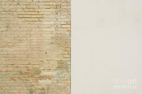 Photograph - Background Of A Wall Half White And Half With Bricks, Divided Into Two Halves. by Joaquin Corbalan