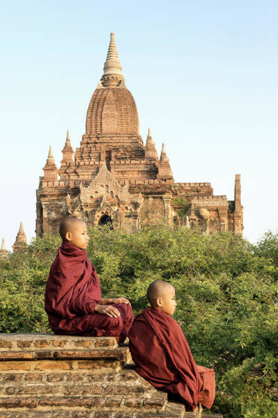 Shaved Head Photograph - Bagan, Buddhist Monks Sitting On Temple by Martin Puddy