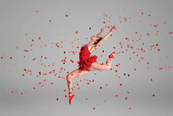 Red Dress Photograph - Ballerina Jumping Through Red Flowers by Nisian Hughes