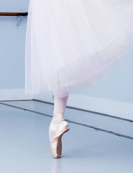 Young Adult Photograph - Ballerina On Pointe Low Angle View by Jonya