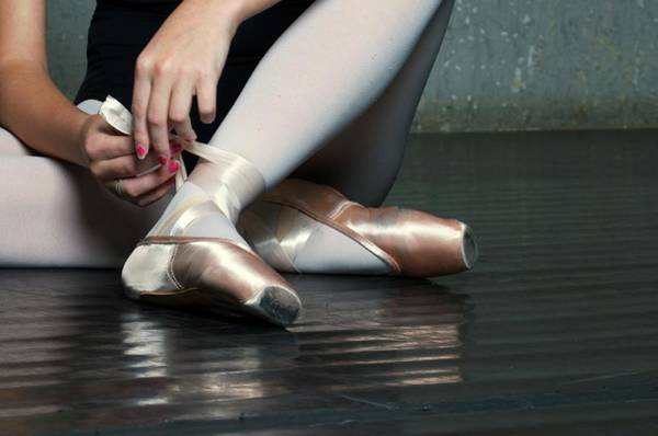 Adolescence Photograph - Ballet Dancer Tying On Slippers by Dlewis33
