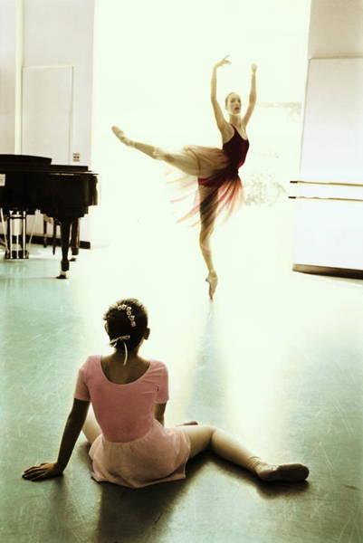 Learning Photograph - Ballet Teacher Demonstrating Arabesque by Jill Sabella