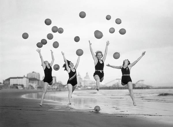 Balloon Dancers On Long Beach Art Print by Bettmann