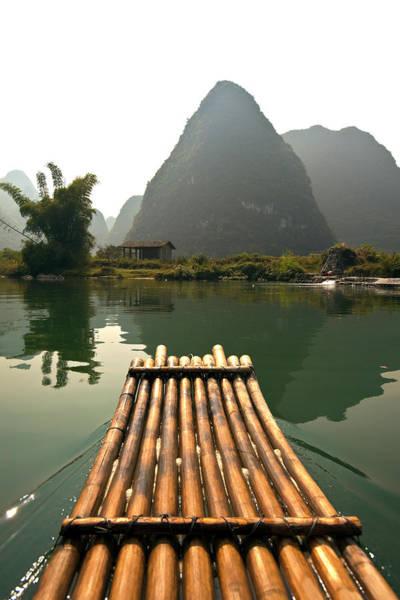 Raft Photograph - Bamboo Raft And Karst Pinnacle, Yulong by John Seaton Callahan