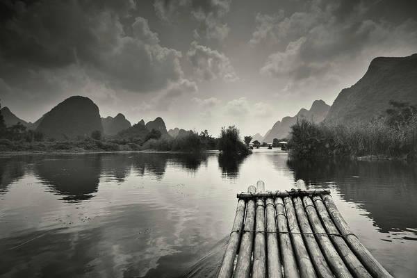 Raft Photograph - Bamboo Raft On Li River by Ipandastudio