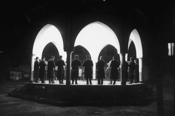 Tunisia Photograph - Band Seen Through Triple Archway As It P by Thomas D. Mcavoy