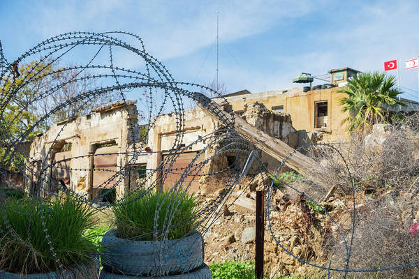 Wall Art - Photograph - Barbed Wire And A Sentry Post At The Un Buffer Zone Green Line by Iordanis Pallikaras