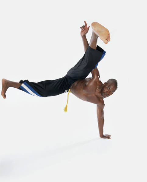 Shaved Head Photograph - Bare Chested Man Break-dancing by Digital Vision