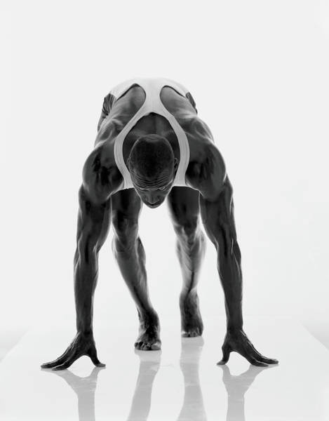 Shaved Head Photograph - Barefoot Sprinter In Starting Position by Mike Powell