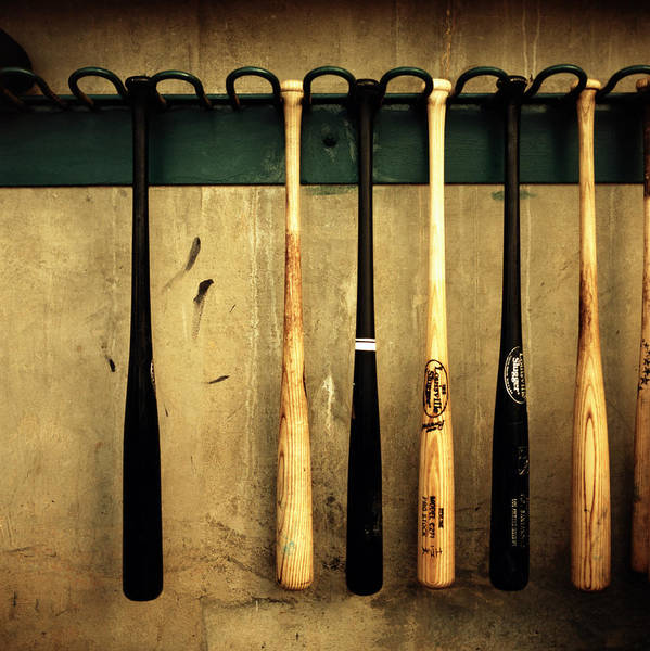 Hanging Photograph - Baseball Bats Hanging On Rack by Michael Kelley