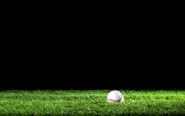 Softball Photograph - Baseball In The Grass At Night by Courtneyk