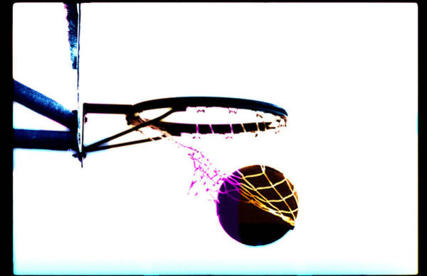 Wall Art - Photograph - Basketball Going Through Net, Close-up by Cyberimage