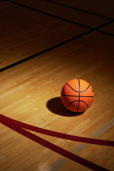 Court Photograph - Basketball On Basketball Court by Thomas Northcut