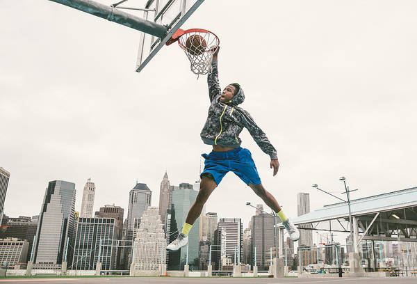 Landmark Wall Art - Photograph - Basketball Player Performing Slum Dunk by Oneinchpunch