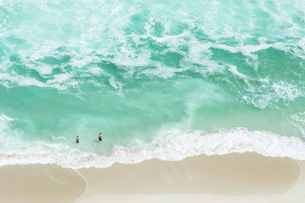 Wall Art - Photograph - Bathers Swimming On Isolated Beach by Peter Chadwick
