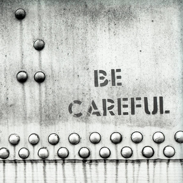 Wall Art - Photograph - Be Careful Text Written On Metal Door by Panoramic Images