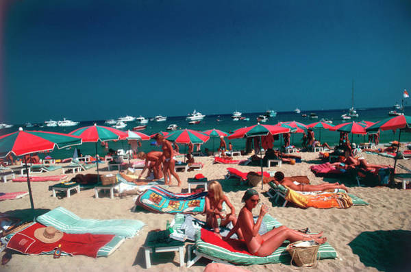 1970 Photograph - Beach At St. Tropez by Slim Aarons
