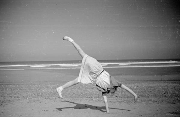 Upside Down Photograph - Beach Cartwheel by Haywood Magee