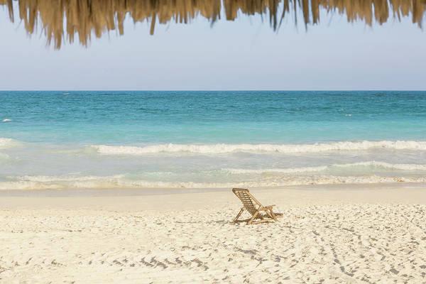 Beach Holiday Photograph - Beach Chair On Beach Next To Ocean by Sasha Weleber