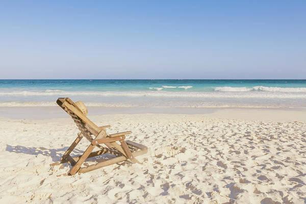 Beach Holiday Photograph - Beach Chair With Hat On Beach Next To by Sasha Weleber
