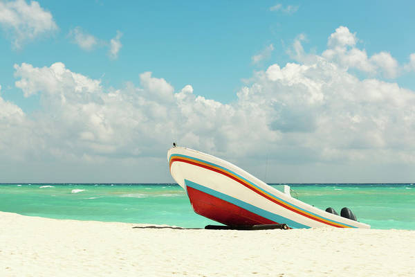 Mayan Riviera Photograph - Beach With Fishing Boat On Caribbean by Yinyang