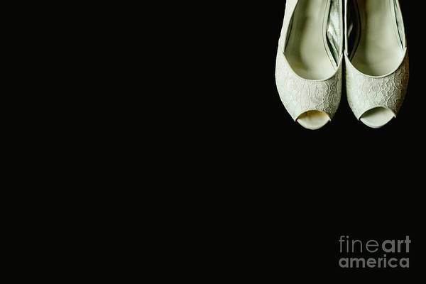 Photograph - Beautiful White Wedding Shoes In A Corner On Isolated Black Background, Copy Space. by Joaquin Corbalan